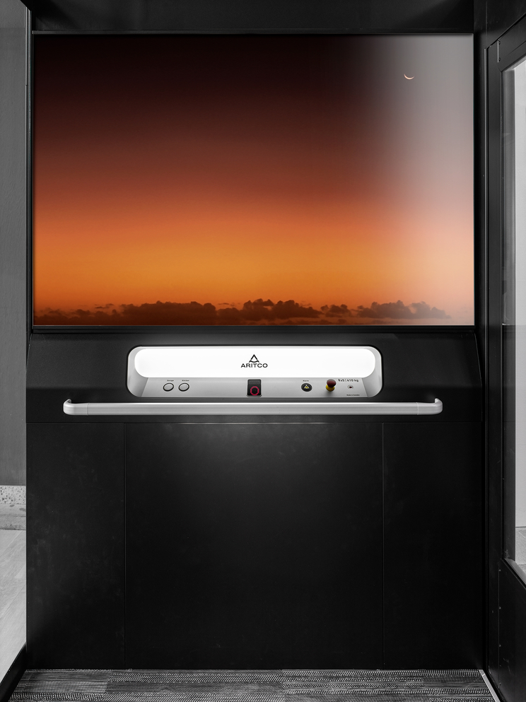 Home elevator Aritco Homelift Access with a designwall of a beautiful sunset